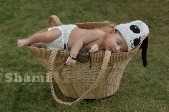 new born girl in basket